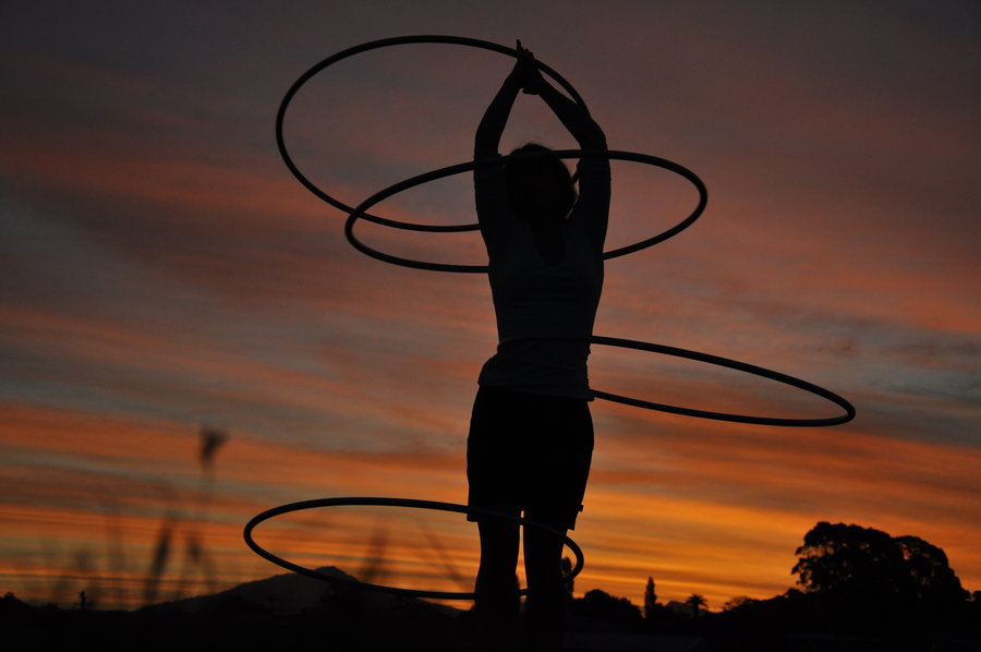 hooping_in_the_sunset_by_0_circus_freak_0-d332jkp.jpg